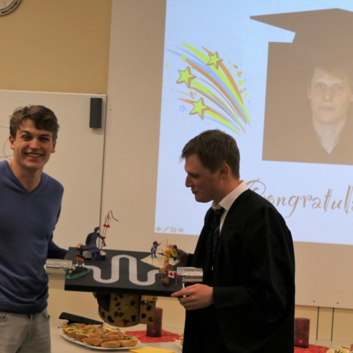 Björn Miksch and Dr. Markus Thiemann celebrating